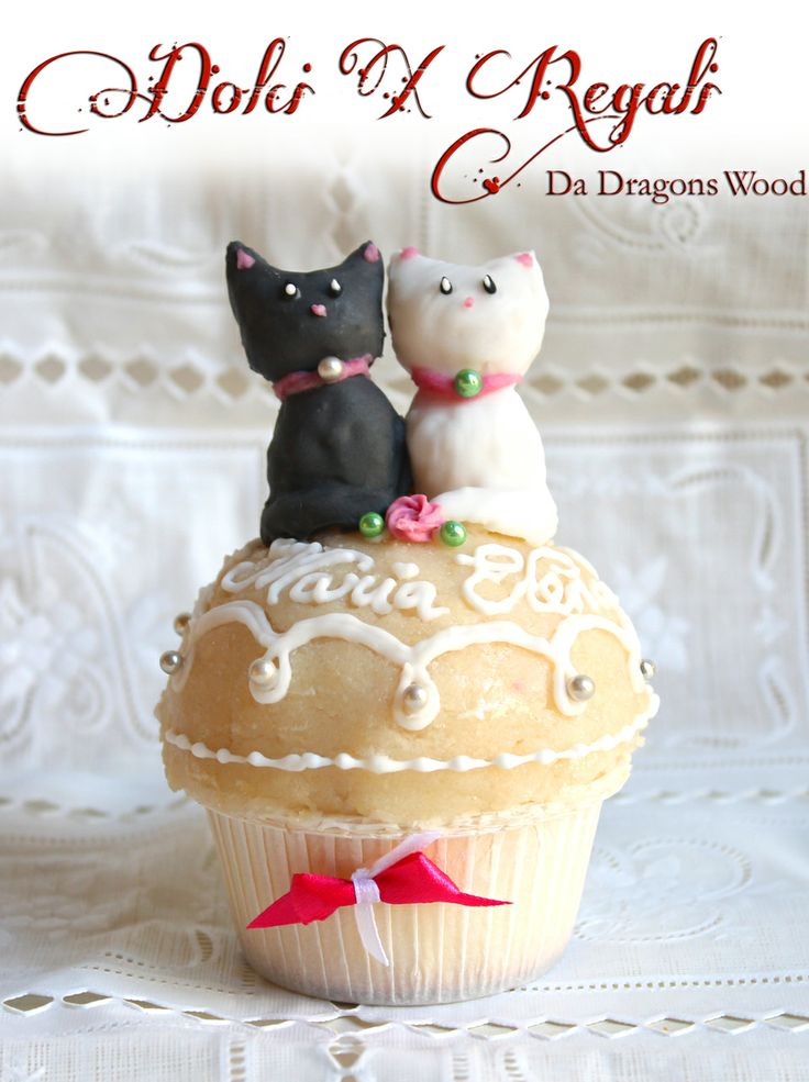 Cats cupcake - Orange curd sponge cake with marzipan (cats are almond paste - contain under 25% almond), royal icing decoration.