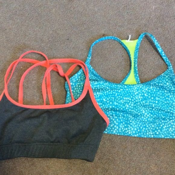 Set of 2 Champion Sports Bras Two cute sports bras in great condition. Gray and coral one has fun strappy back. The blue and green one is reversible. Both are dry fit material and super comfortable. Champion Intimates & Sleepwear Bras