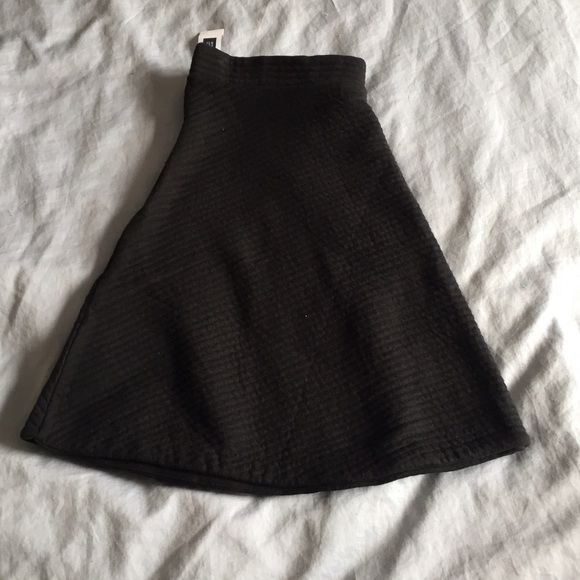 NWT Gap Black Skater Skirt Winter weight, quilted black skater skirt is absolutely adorable.  Throw on tights and a cute sweater and you are ready to go!  Zips up the side.  New with tags- Size Large. GAP Skirts Circle & Skater