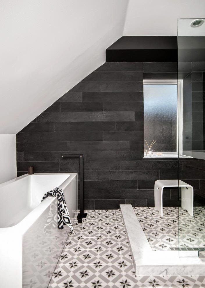 Great use of dark and light colors.  The black hardwood pops and adds a focal point for this bathroom!