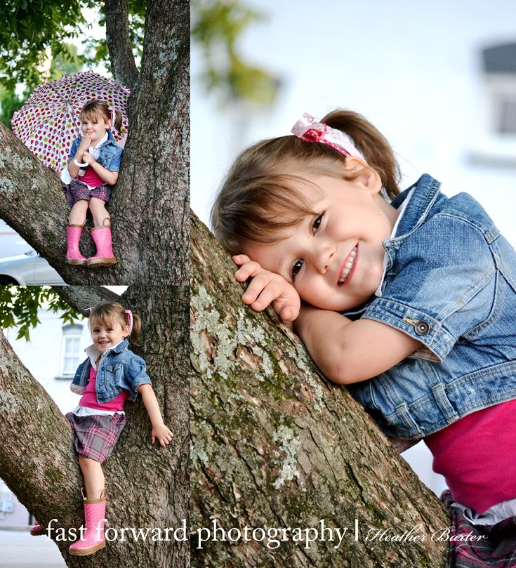 child photography 3 year old girl jean jacket tree pose girly umbrella piggy tales pink ribbon plaid skirt rain boots downtown