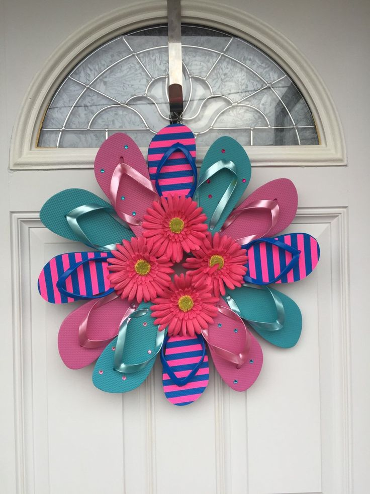 "Flip Flop Stripe and Daisy Sun Fun, Decorate your door or room with the summer footwear we love to wear. This wreath is fastened with greening pins making it sturdy and heat resistant. The wreath measures approximately 22"" across, includes 12 youth flip flops and comes with a daisies and rhinestones. Please avoid displaying this wreath in between a storm and house door. Too much direct sunlight causes extreme heat built up."