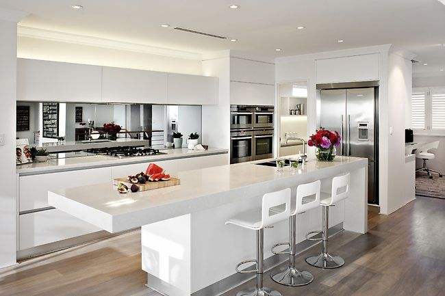 All white kitchen with waterfall to one end