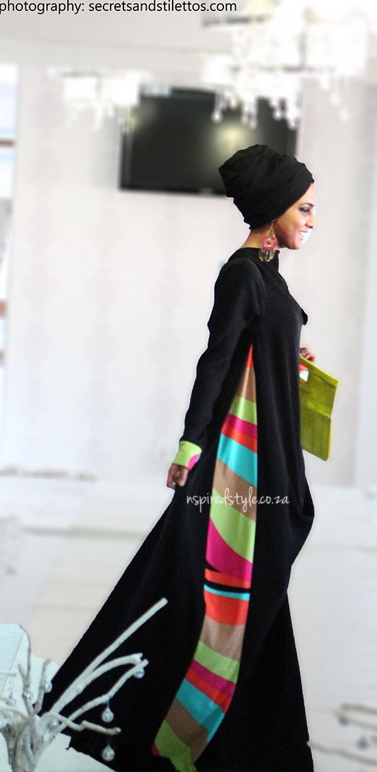 This abaya is perfect for the woman who prefers to wear black but wants to add a dash of color in the summertime.  A pink or lime green handbag complements the ensemble without going overboard - Habiba West