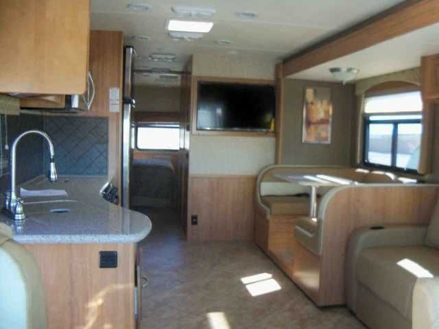 2015 New Coachmen MIRADA 32UD Class A in Nevada NV.Recreational Vehicle, rv, MSRP $132389 Our Price $107558 !!Interior Appointments. Glides ThroughoutGobi Wall Board - CoachSaddle Wall Board - AccentAntique Nickel HardwareHardwood Cab Doors / flat panelRadius Slider Windows w/ Safety GlassReclining / Swivel Pilot SeatsSoft Touch Jackknife Sofa Mini-Blinds in Living Room / KitchenResidential Curtains in BedroomInterior EquipmentRadio AM/FM/CDLP Leak Alarm and Smoke DetectorCarbon Monoxide…