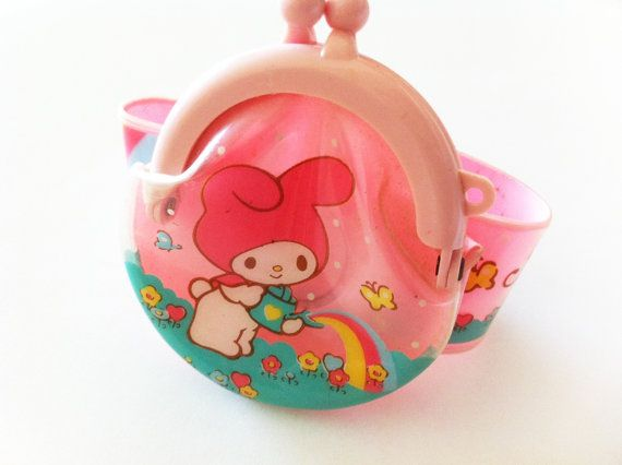 I can't believe how much the toys I used to play with now cost on Etsy! Vintage Sanrio 1988 My Melody Wristlet Coin Purse. $30.00, via Etsy.