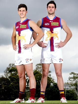 Sam Mayes and Michael Close model the new Brisbane Lions clash jumper. Picture: Steve Poh
