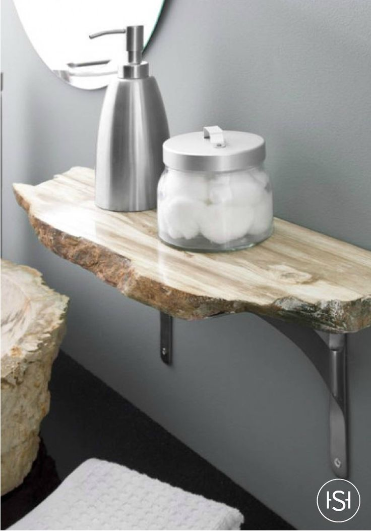 This Natural Petrified Wood Shelf is perfect for those who love nature with an edge. Easily mount in your bathroom to rest your personal items on to save space. Each shelf has a different size and shape, lending its unique character that is like no other.
