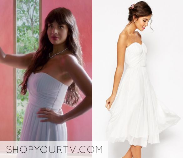 """Tahani Al-Jamil (Jameela Jamil) wears this white ruched bandeau chiffon midi dress in this episode of The Good Place, """"Dance Dance Revolution"""". It is the ASOS WEDDING Ruched Bodice Bandeau Midi Dress."""