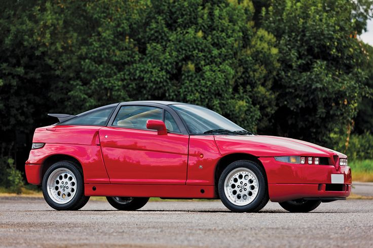 1990 Alfa Romeo SZ. This modern interpretation of the Sprint Zagato was also known internally as the ES-30, or Experimental Sports Three-Liter. This low-production, high-performance automobile was designed by Robert Opron and Antonio Castellana.