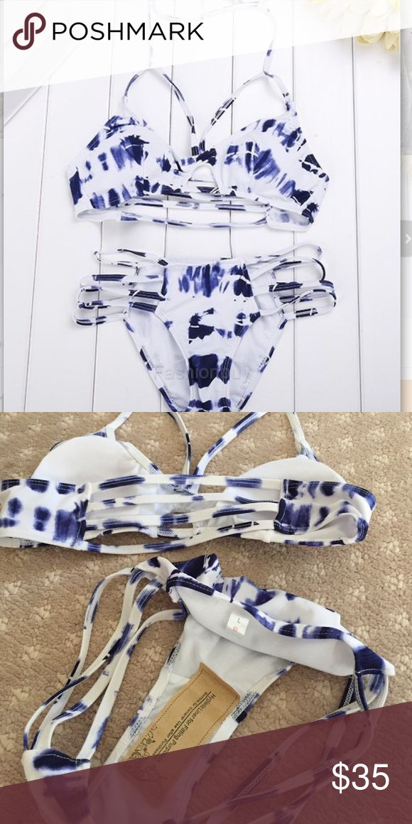 New! Blue and White bikini set Blue and White bikini. Brand new, never worn. Bottom and top are both a size large. SPORT Swim Bikinis
