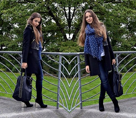 Fashion blogger style, black coat, boots and blue scarf