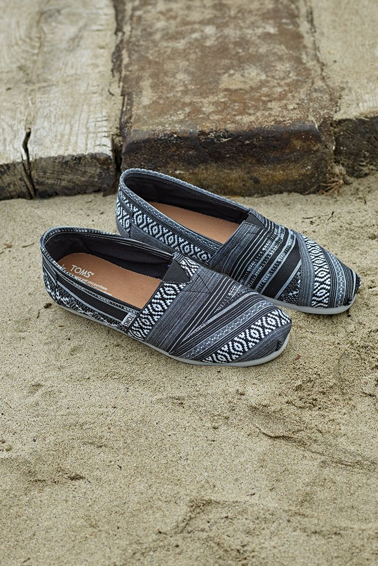 Liven things up with these TOMS slip-on shoes in a unique black and white cultural woven print.