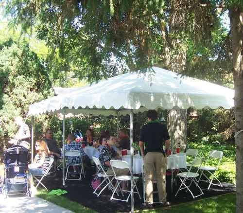 Image of backyard party using a small frame tent
