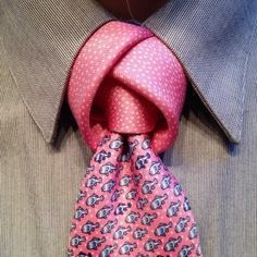 The Tulip Knot - This knot is from the loose fit range of tie knots. It is one of the most striking looking knots that you can tie and will always attract attention. It's tied a little bit like the Eldredge, but with the loose bits to give that extra space. in your face and flashy, so where it somewhere where it will fit in. Elton John's Oscars party perhaps