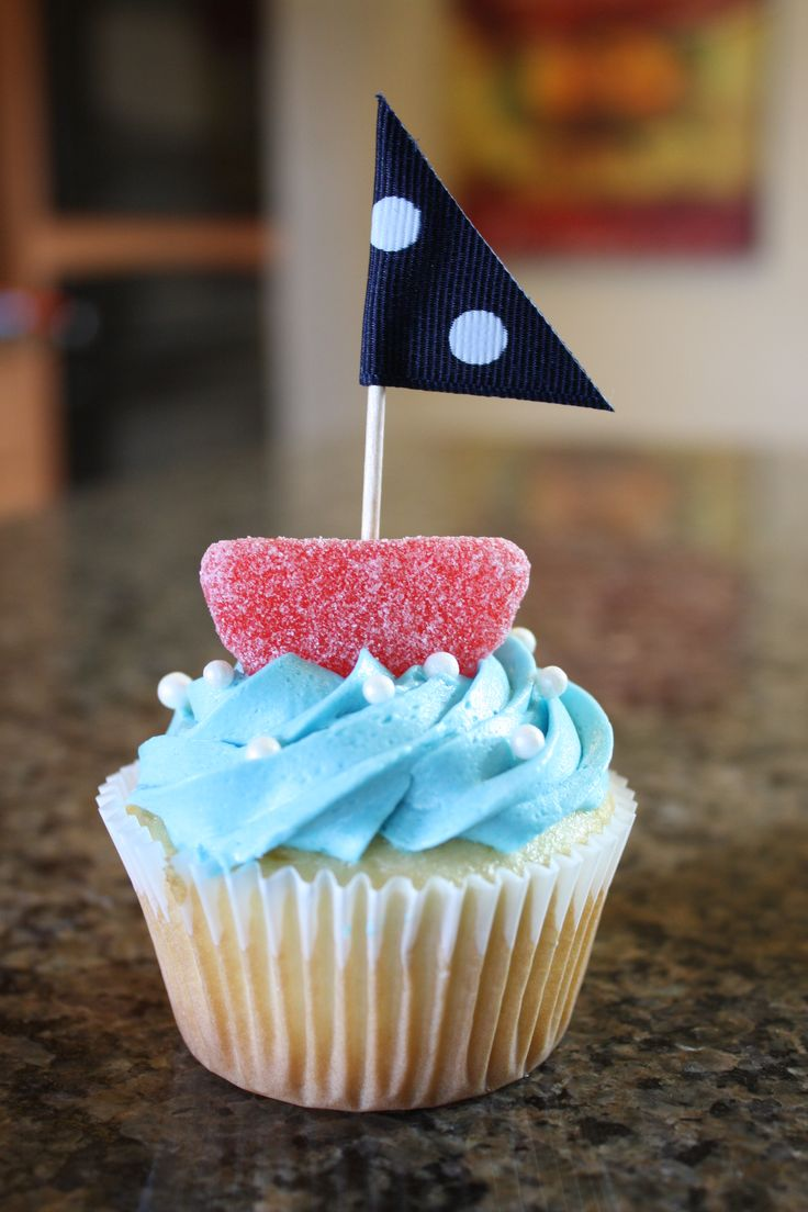 ahoy it's a boy-sailboat cupcake made with  cherry slice candy, toothpicks, and ribbon. easy DIY