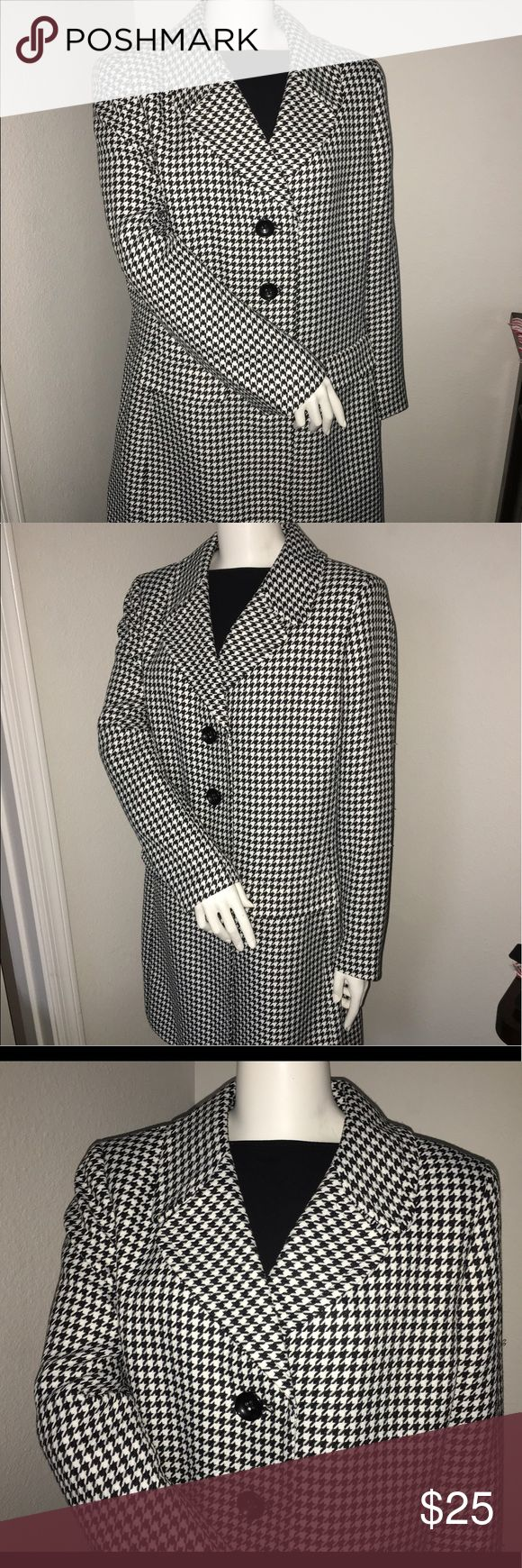 "Le Suit plus size peacoat sz: 18 Le Suit brand Thank you for viewing my listing, for sale is a women's, Le Suit brand, black & white, Longsleeve, but and up/down, pea coat, with shoulder pads.  Plus size: 18  If you have any questions or would like additional photos please feel free to ask.  From under one arm to under the other measures appx 23"" from the top of the shoulder to the bottom of the T-shirt measures appx 37"" Le Suit Jackets & Coats Pea Coats"