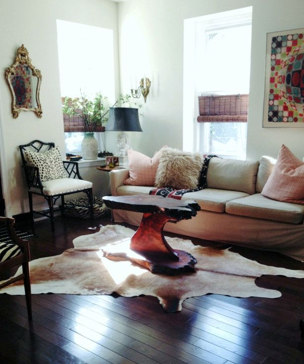 Living Room Decorating Ideas Cowhide Rug Under Unique Table With