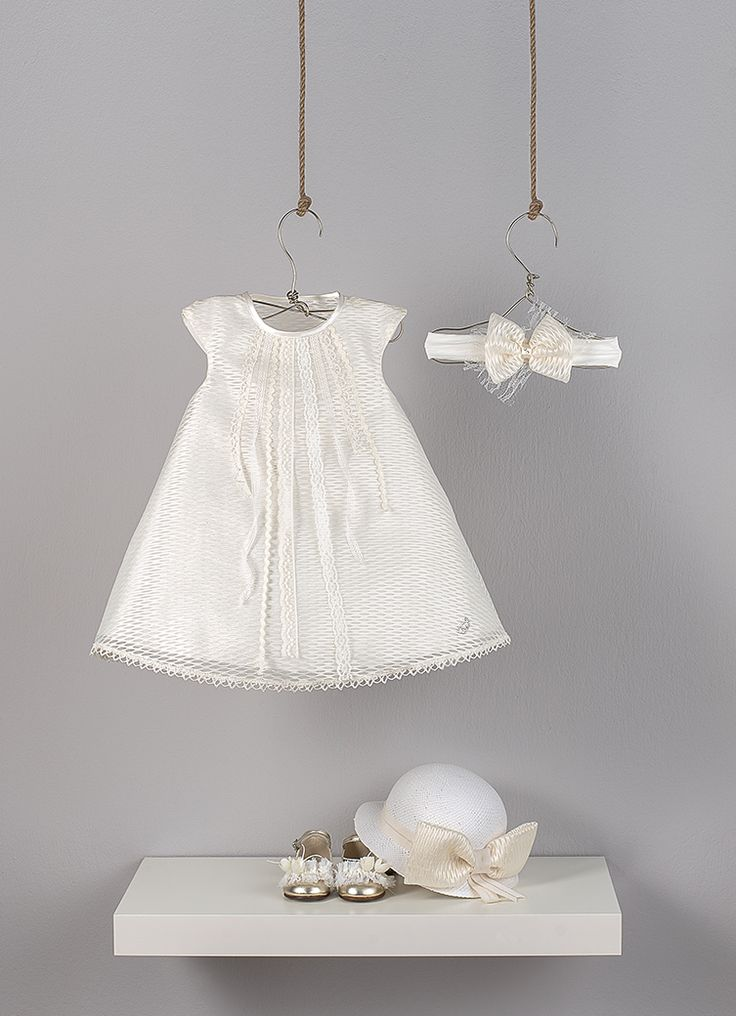 Ecru dress in line '' A '' from organza with embossed motif, decorated with different  kind of ribbon laces and big satin bow on the back  Ecru elastic ribbon decorated with bow made in organza fabric  ecru straw hat decorated with large bow made in organza fabric