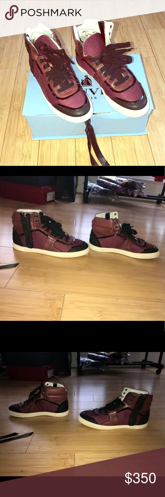 Lanvin High Top Sporty Basket Sneakers Size 35 Lanvin High Top Sporty Basket Sneaker Color: Aubergine/Eggplant 100% Lamb Skin Leather Size: 35 Excellent condition! Worn a handful of times, can add more pics if necessary. Selling because too small, love these sneakers and they are very comfortable! Lanvin Shoes Sneakers