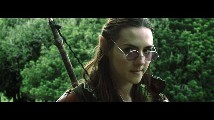 Q the Elf with her glasses