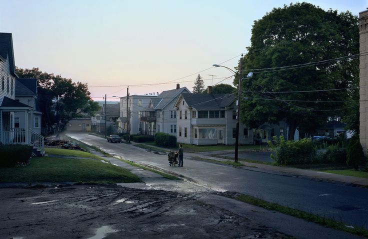 Gregory Crewdson:  A picture I imagine looking down that street and there would be like a lone figure sort of wandering, carting possessions in a cart – and there he is. I think that's a sign. I think that's – I know that guy.