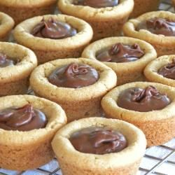 Peanut Butter Fudge Puddles.  Peanut butter cookies baked in a mini muffin tin then filled with a spoonful of homemade chocolate fudge.  Mmm!