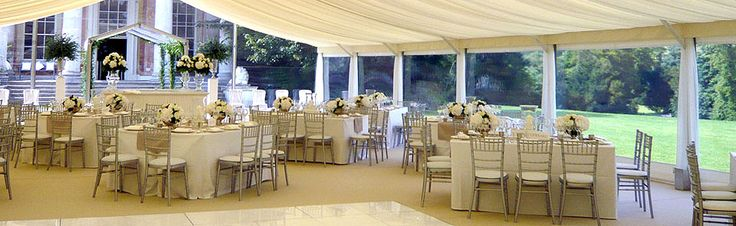 Top Hat Marquees - enjoy the view at your wedding venue, choose square tables for a different look and use our cream dance floor to maintain the colour scheme