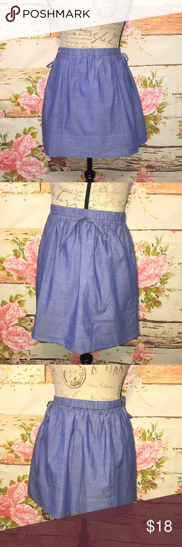 """J. Crew Mini Skirt NWOT! J. Crew size small blue mini skirt. Elastic waistband with 2 self-tie drawstrings on each hip to make a bow. Puckered beneath waist. Fully lined. Waist: 13"""", Hips: 21"""", Length: 15"""". 100% Cotton. Never worn! Retail: $59.50 J. Crew Skirts Mini"""