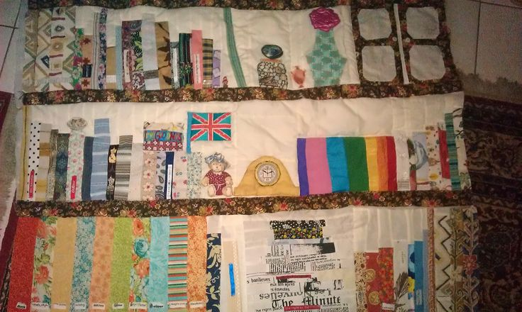 Three shelves of a book quilt