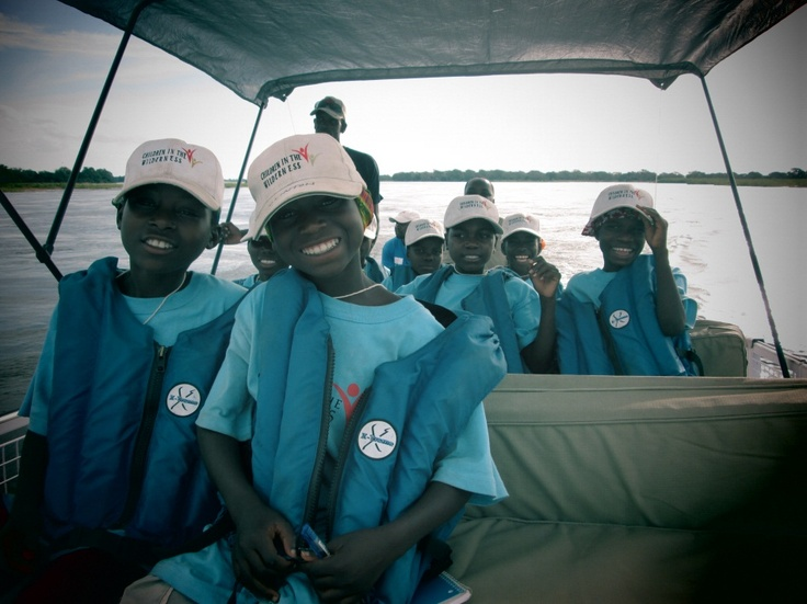 """""""Believe me, my young friend, there is NOTHING--absolutely nothing--half so much worth doing as simply messing about in boats."""" CITW Ruckomechi campers take a boat ride on the Zambezi River."""