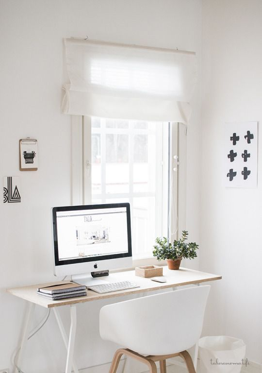 minimal home decor - stylish work place with white desk and chair.