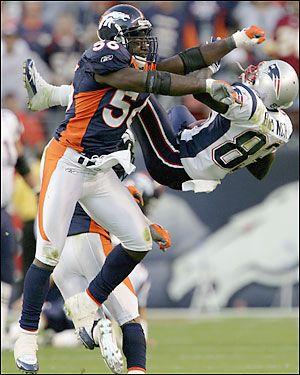 nfl football | Former Denver Broncos linebacker Al Wilson lays a hit on former New ...