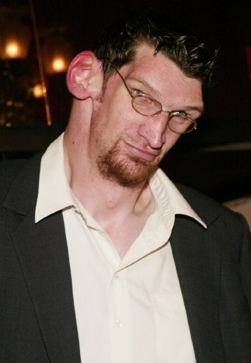 "Matthew McGrory, Originally a student of pre-law at Widener University, and later majoring in Criminal Justice at West Chester University, Matthew started his career by making appearances on The Howard Stern Show, The Oprah Winfrey Show, and music videos of Iron Maiden, Marilyn Manson, and Blondie. Matthew would later amass a cult following for memorable roles such as ""Tiny"" in Rob Zombie's House of 1000 Corpses"" He lived in Sherman Oaks, California, with his girlfriend Melissa. On August 9…"