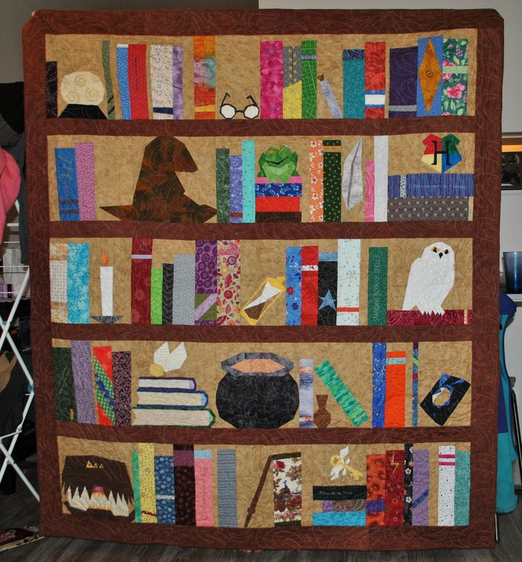 Harry Potter bookshelf quilt. I got the blocks from fandominstitches.com, under the 'Harry Potter bookcase' section. I made this for a friend who is a major HP fan, as well as an incurable bookworm. It took me a solid month of stitching to make it.