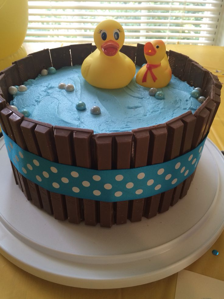 """Rubber duck kit kat cake. Two-layer yellow cake inside. Homemade buttercream icing. Full-sized Kit Kat cut to size and covered with ribbon. Sixlets candies for """"bubbles""""."""
