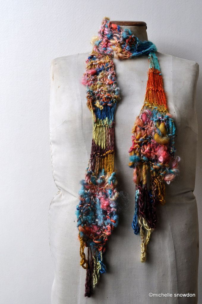 unique!! (i know this is knitting ... but it can be translated easy to crochet!) ... love the colors and textures!