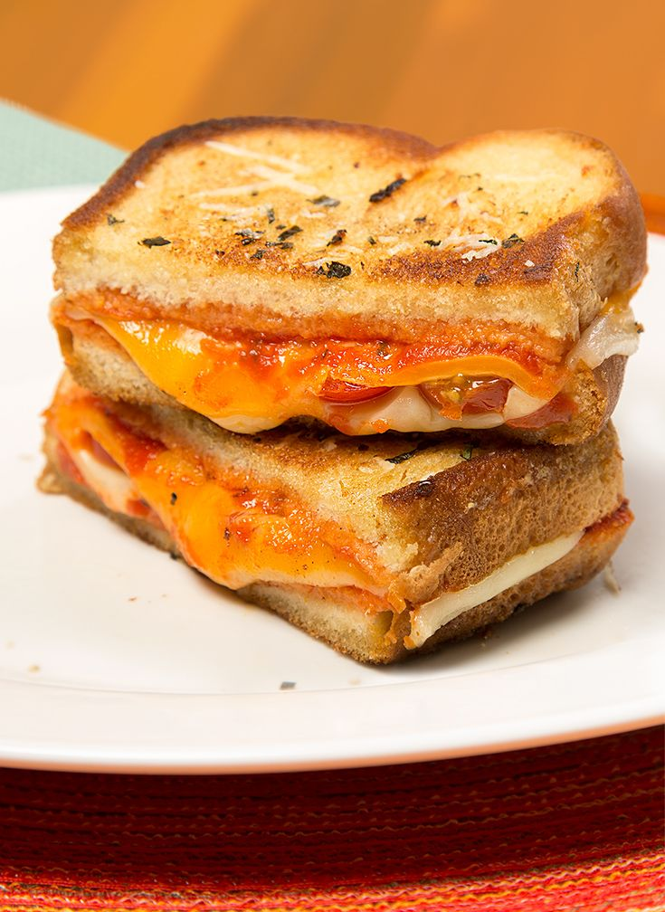 Pizza Grilled Cheese: Take a trio of cheeses, fresh tomatoes, your favorite marinara and pizza seasonings. Layer them between thick-sliced Sara Lee Artesano Bread. Then cook to ooey-gooey, golden brown perfection!