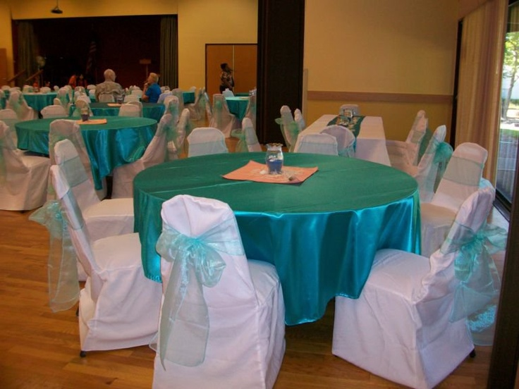 Satin Turquoise Tablecloth And Organza Sashes Tied Around White Banquet  Chair Covers