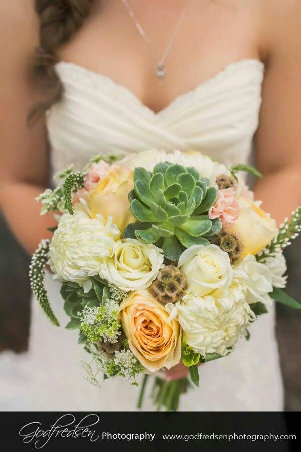 Beautiful Bridal bouquet made with succulents, scabiosas, light pink stock,  butterscotch garden roses, veronica, innocencia roses, queen anne's lace and commercial chrysanthemums.  Made by Myra Rose Florist in Winnipeg, MB.  Free Wedding Consultations!
