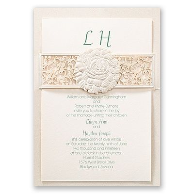 A beautifully embossed rose takes center stage on this ecru shimmer, laser cut wedding invitation while an elegant filigree pattern presents the flower to your wedding guests with grace and elegance. An ecru card with your wording is inserted behind the rose. Your wording is printed in your choice of color and fonts. Inner and outer envelopes are included. This product features thermography printing, an affordable printing process that results in raised lettering.  Please note: a slight…
