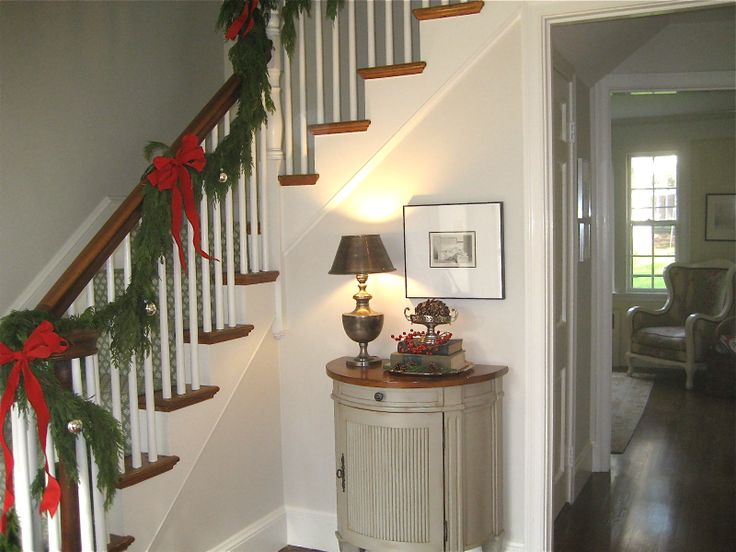 9 best images about stairway decorating on pinterest for Stair railing decorated for christmas