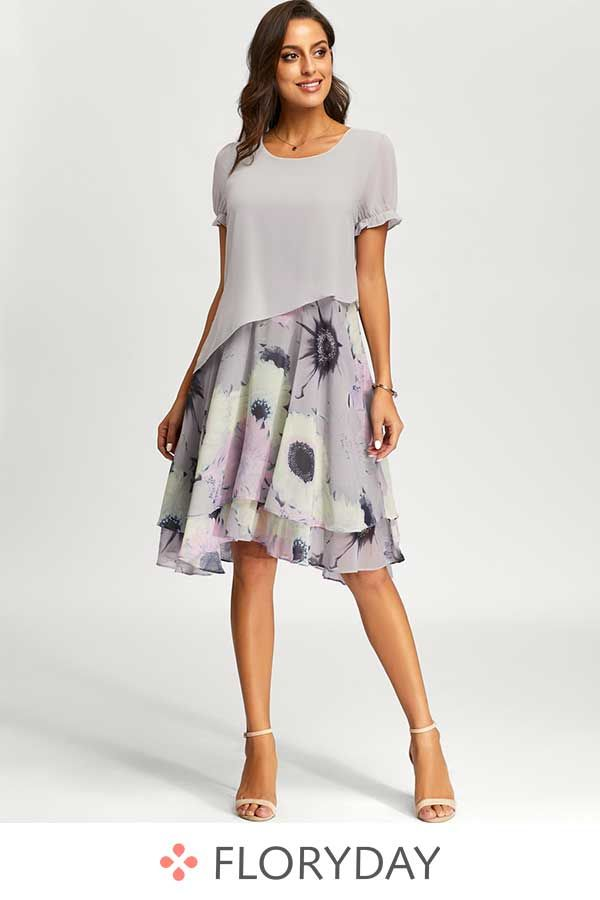 Mid-length dress with short sleeves and floral pattern