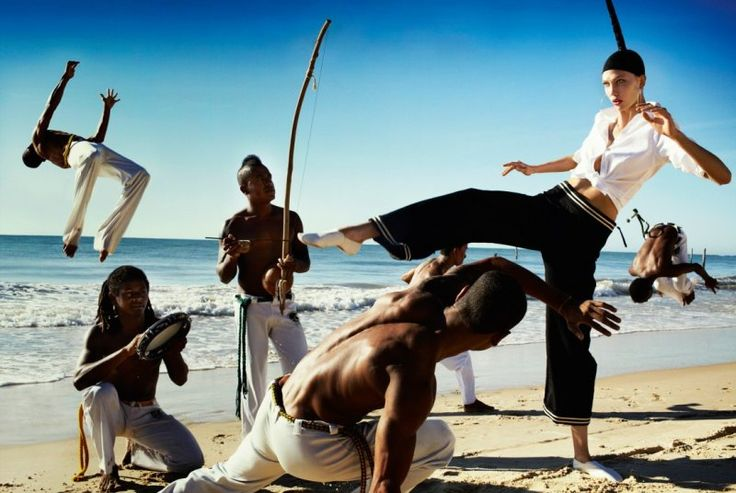 Brazilian Treatment – Mario Testino teams up with American beauty Karlie Kloss for a story lensed in Bahia, Brazil for the July issue of Vogue US. Stylist Phyllis Posnick selects a wardrobe of colorful looks for Karlie to wear as she heads to the beaches and other stunning sights of Bahia. Whether posing with Capoeira dancers or exploring the outdoors, Karlie enchants in every image.