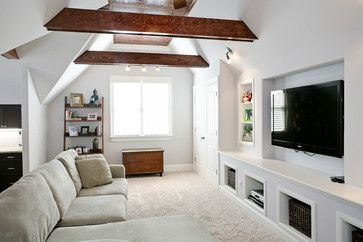 Living room in attic--love the built ins and TV in wall.