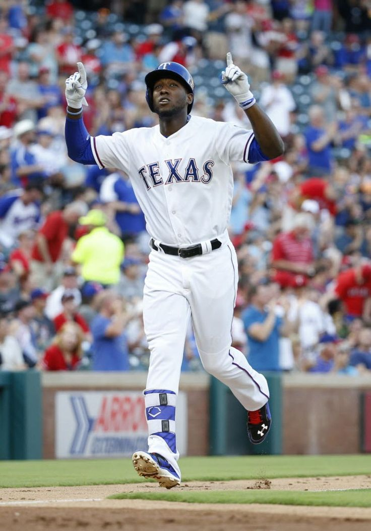 Texas Rangers second baseman Jurickson Profar (19) celebrates after hitting a…