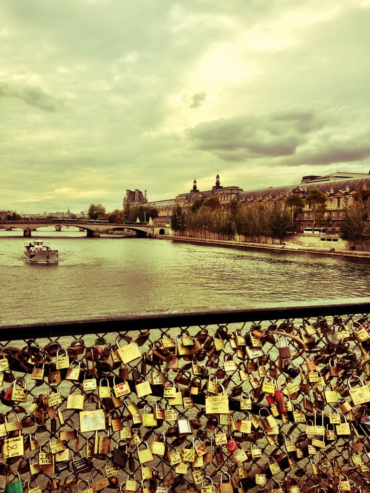 Buy a lock, write your names on it, and throw the key in the river! #Paris