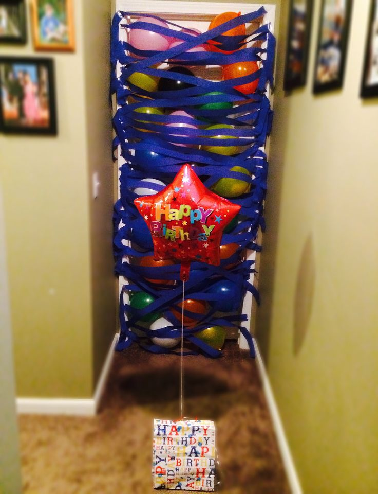 A balloon avalanche as a birthday morning surprise. I did this for my boyfriend's 19th birthday and he was shocked! It was the first time I could finally pull off a surprise without him knowing and he loved it.