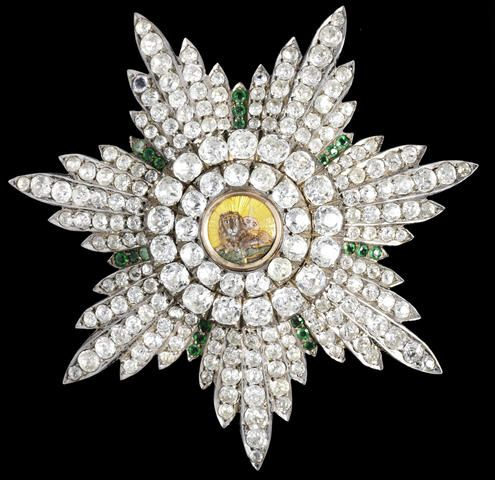 A paste-set silver, gold and enamel Breast Star of the Qajar Order of the Lion and Sun Russia, circa 1870 7.8 cm. diam.