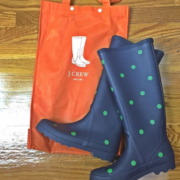 J.Crew Polka-Dot Wellies Navy wellies from J.Crew with adorable green polka dots. The Wellies have been worn a few times but are in great shape. The only signs of wear at all are the soles and slight wear inside the boots, otherwise they look brand new. These are a size 7 and fit true to size. Will send with the boot dust bag. J. Crew Shoes Winter & Rain Boots